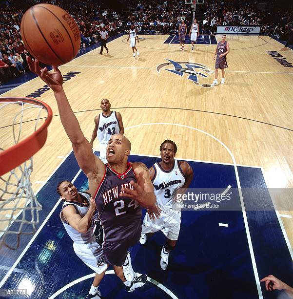 Richard Jefferson of the New Jersey Nets drives to the basket against the Washington Wizards during the NBA game at the MCI Center on February 21...