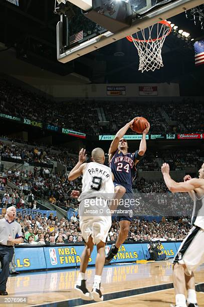 Richard Jefferson of the New Jersey Nets drives to the basket against Tony Parker of the San Antonio Spurs in Game one of the 2003 NBA Finals at SBC...
