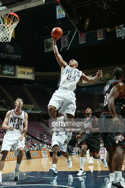Richard Jefferson of the New Jersey Nets drives to the basket against the Philadelphia 76ers at Continental Airtlines Arena on October 14 2003 in...