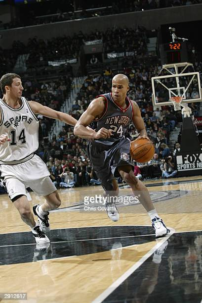 Richard Jefferson of the New Jersey Nets drives to the basket against Hidayet Turkoglu of the San Antonio Spurs during the game on January 21 2004 at...