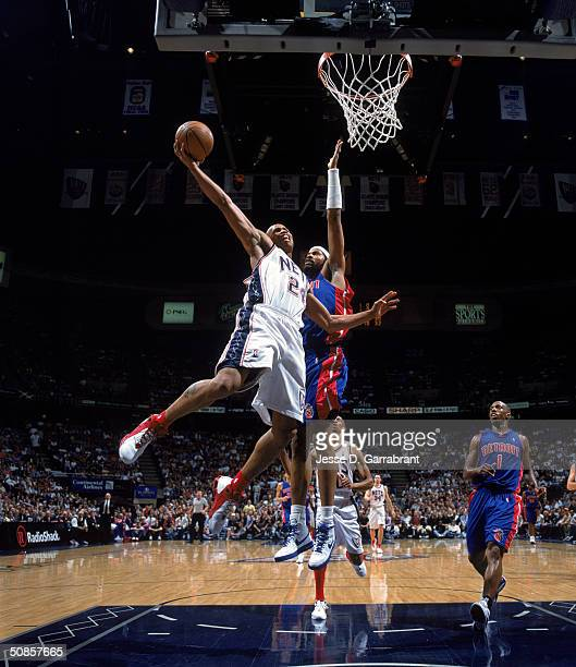 Richard Jefferson of the New Jersey Nets drives to the basket against Rasheed Wallace of the Detroit Pistons in Game Four of the Eastern Conference...