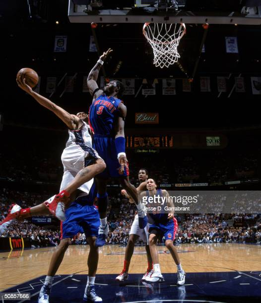 Richard Jefferson of the New Jersey Nets drives to the basket against Ben Wallace of the Detroit Pistons in Game Four of the Eastern Conference...