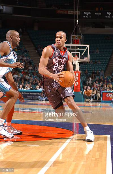 Richard Jefferson of the New Jersey Nets drives to the basket against the Charlotte Hornets at the Charlotte Coliseum in Charlotte North Carolina...