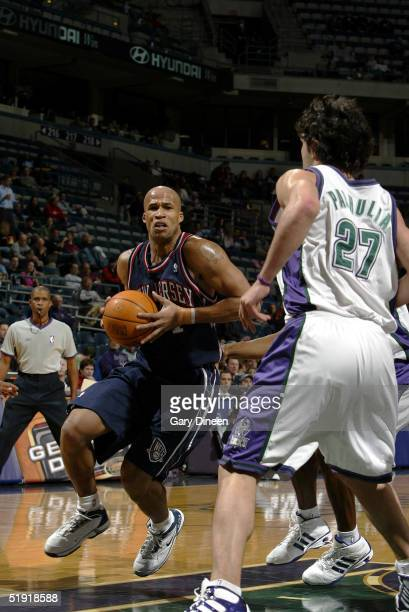 Richard Jefferson of the New Jersey Nets drives to the basket against Zaza Pachulia of the Milwaukee Bucks at the Bradley Center on January 5 2005 in...