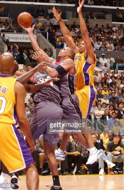Richard Jefferson of the New Jersey Nets drives to the basket against the Los Angeles Lakers during game two of the 2002 NBA Finals at the Staples...