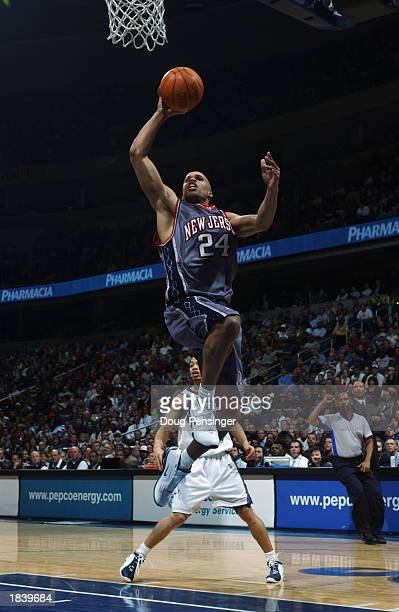 Richard Jefferson of the New Jersey Nets drives to the basket during the NBA game against the Washington Wizards at MCI Center on February 21 2003 in...