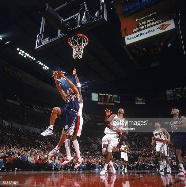 Richard Jefferson of the New Jersey Nets drives to the basket past Zach Randolph of the Portland Trail Blazers during a game at The Rose Garden on...