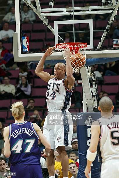 Richard Jefferson of the New Jersey Nets dunks against Andrei Kirilenko of the Utah Jazz at Continental Arena December 17 2003 in East Rutherford New...