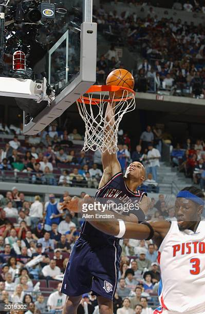 Richard Jefferson of the New Jersey Nets dunks over Ben Wallace of the Detroit Pistons in Game one of the Eastern Conference Finals during the 2003...