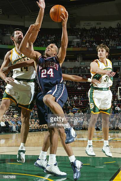 Richard Jefferson of the New Jersey Nets goes to the basket against the Seattle SuperSonics at Key Arena in Seattle Washington NOTE TO USER User...