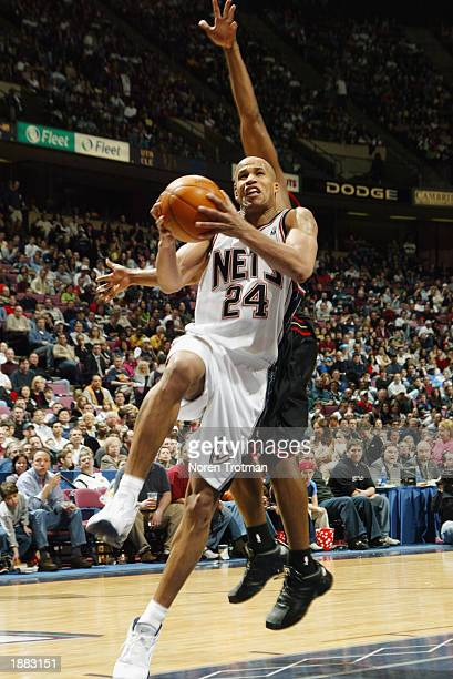 Richard Jefferson of the New Jersey Nets goes to the basket against the Philadelphia 76ers during the game at Continental Airlines Arena on March 16...