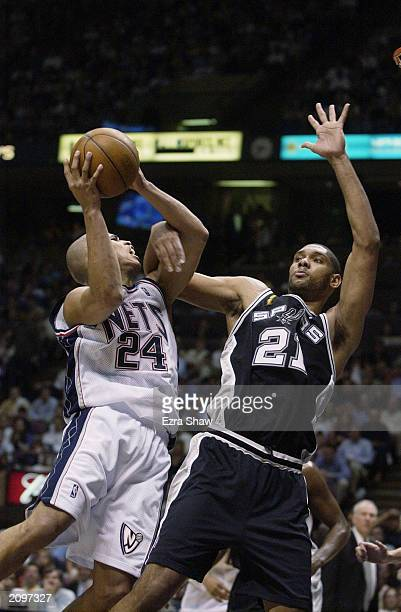 Richard Jefferson of the New Jersey Nets goes to the basket against Tim Duncan of the San Antonio Spurs in Game four of the 2003 NBA Finals at...