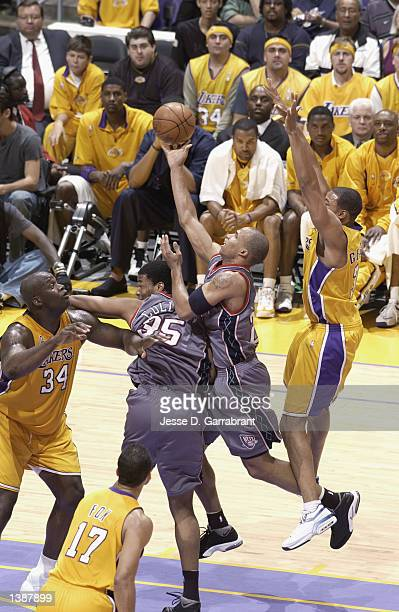 Richard Jefferson of the New Jersey Nets goes to the basket past Devean George of the Los Angeles Lakers during Game two of the 2002 NBA Finals on...