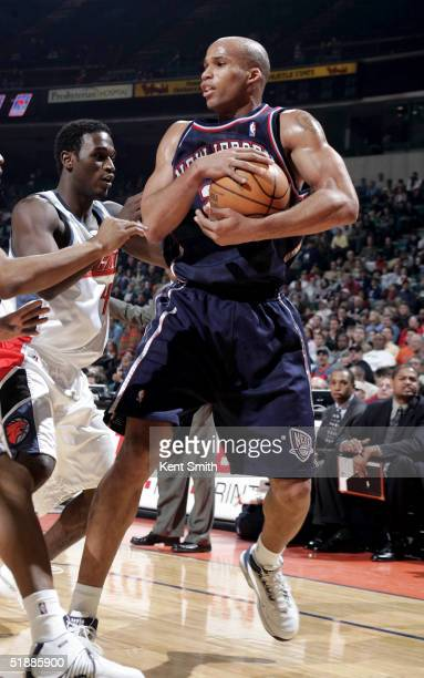 Richard Jefferson of the New Jersey Nets guards the ball against Kareem Rush of the Charlotte Bobcats on December 21 2004 at the Charlotte Coliseum...