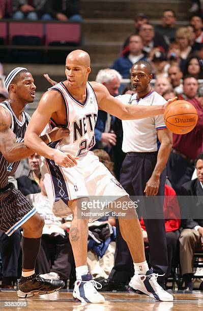 Richard Jefferson of the New Jersey Nets is defended by DeShawn Stevenson of the Orlando Magic during the game at Continental Airlines Arena on April...