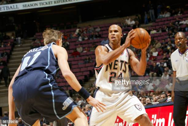 Richard Jefferson of the New Jersey Nets looks to pass against Andrei Kirilenko of the Utah Jazz at the Continental Airlines Arena on November 9 2005...