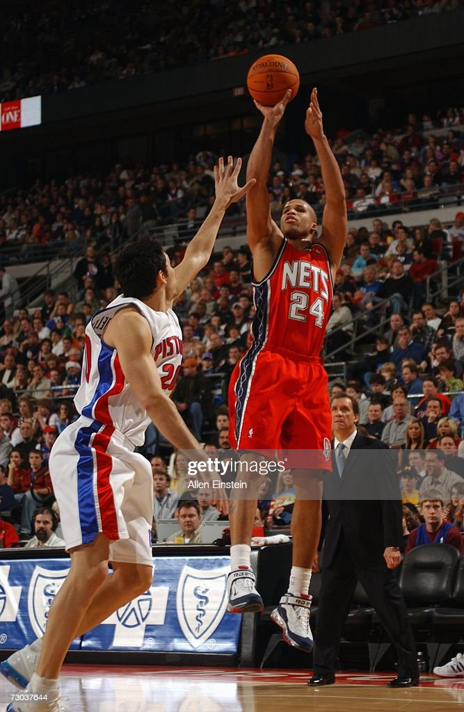 Richard Jefferson #24 of the New Jersey Nets shoots a jump shot over Carlos Delfino #20 of the Detroit Pistons during a game at the Palace of Auburn Hills on December 26, 2006 in Auburn Hills, Michigan. The Pistons defeated the Nets 92-91.