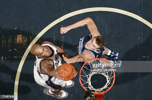 Richard Jefferson of the New Jersey Nets shoots against Andrei Kirilenko of the Utah Jazz on November 8 2006 at Continental Airlines Arena in East...