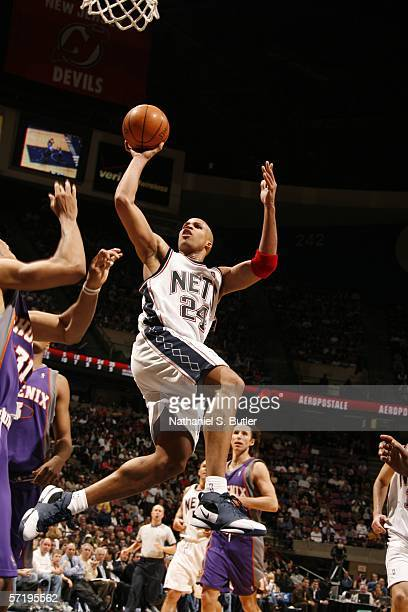 Richard Jefferson of the New Jersey Nets shoots against Shawn Marion of the Phoenix Suns on March 27 2006 at the Continental Airlines Arena in East...
