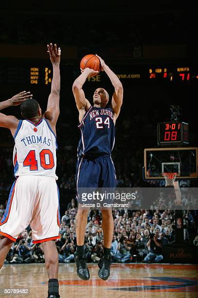 Richard Jefferson of the New Jersey Nets shoots over Kurt Thomas of the New York Knicks in Game three of the Eastern Conference Quarterfinals during...