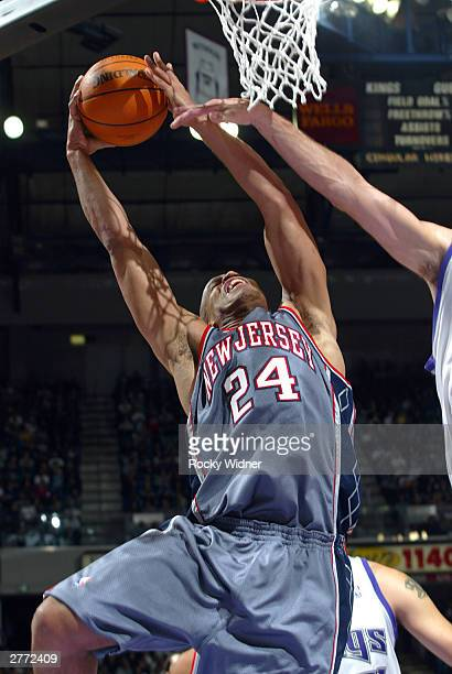 Richard Jefferson of the New Jersey Nets takes the ball to the basket against the Sacramento Kings November 30 2003 at Arco Arena in Sacramento...