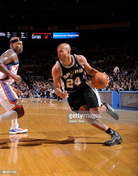 Richard Jefferson of the San Antonio Spurs drives against Al Harrington the New York Knicks on December 27 2009 at Madison Square Garden in New York...