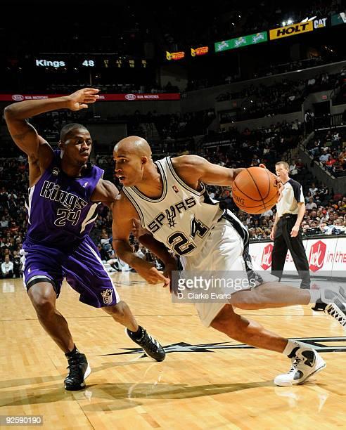 Richard Jefferson of the San Antonio Spurs drives against Desmond Mason of the Sacramento Kings on October 31 2009 at the ATT Center in San Antonio...