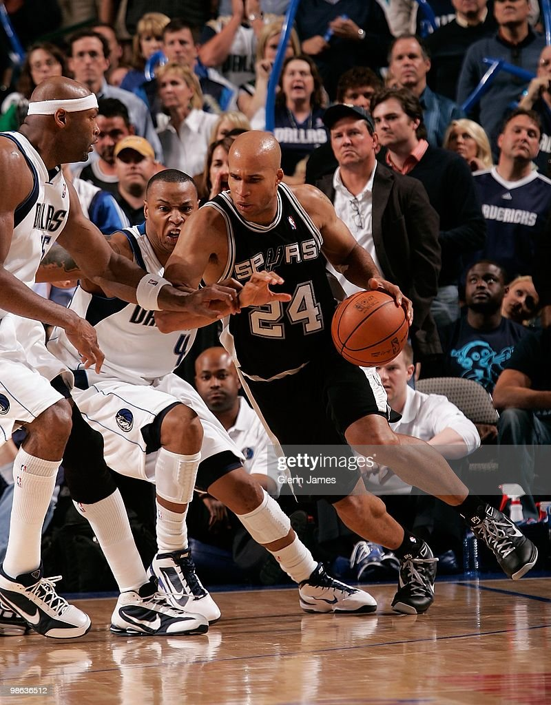 Richard Jefferson #24 of the San Antonio Spurs moves the ball against Caron Butler #4 and Erick Dampier #25 of the Dallas Mavericks in Game One of the Western Conference Quarterfinals during the 2010 NBA Playoffs on April 18, 2010 at the American Airlines Center in Dallas, Texas. The Mavericks won 100-94.
