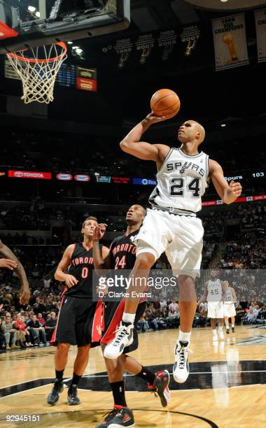 Richard Jefferson of the San Antonio Spurs shoots against Marco Belinelli and Sonny Weems of the Toronto Raptors on November 9 2009 at the ATT Center...
