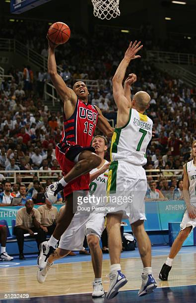 Richard Jefferson of the United States drives on Saulius Stombergas of Lithuania during the men's basketball bronze medal contest game on August 28...
