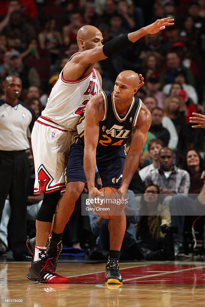 Richard Jefferson #24 of the Utah Jazz looks to pass the ball against Taj Gibson #22 of the Chicago Bulls on November 8, 2013 at the United Center in Chicago, Illinois.