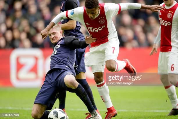 Richard Jensen of FC Twente David Neres of Ajax during the Dutch Eredivisie match between Ajax v Fc Twente at the Johan Cruijff Arena on February 11...