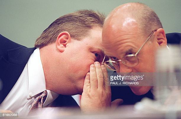 Richard Jewell confers with his attorney Watson Bryant 30 July while testifying before the US House Committee On The Judiciary in Washington DC At...