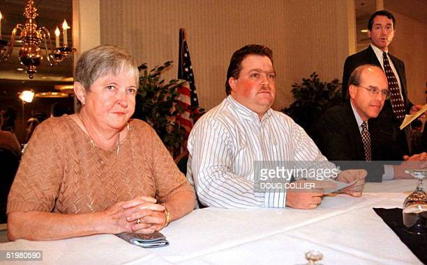 Richard Jewell his mother Barbara and attorneys Watson Bryant and Wayne Grant look on during a press conference 28 October in Atlanta Ga Jewell was...