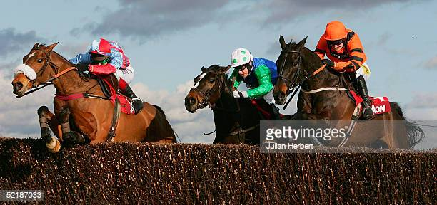 Richard Johnson and Farmer Jack jump the final fence in company with the Timmy Murphy ridden Celestial Gold and the Ruby Walsh partnered Strong Flow...