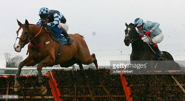 Richard Johnson and Gold Medalist lead Robert Thornton riding Pole Star over the last flight before landing The Sidney Banks Memorial Novices Hurdle...