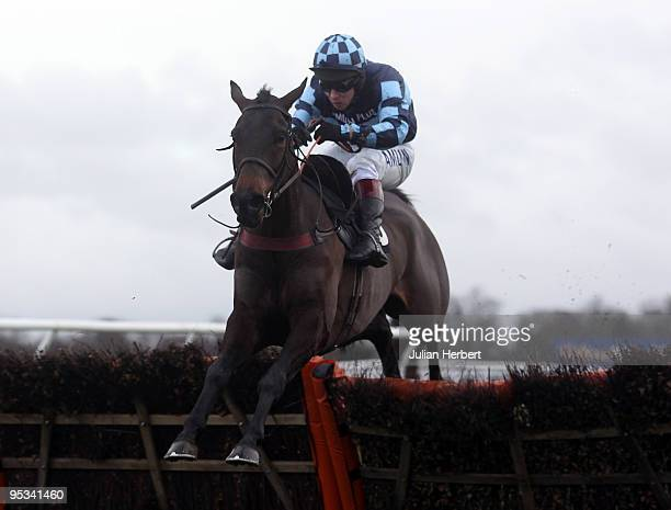 Richard Johnson and Menorah clear the last flight to land The williamhillcomBonus25 Novices' Hurdle Race run at Kempton Park on December 26 2009 in...