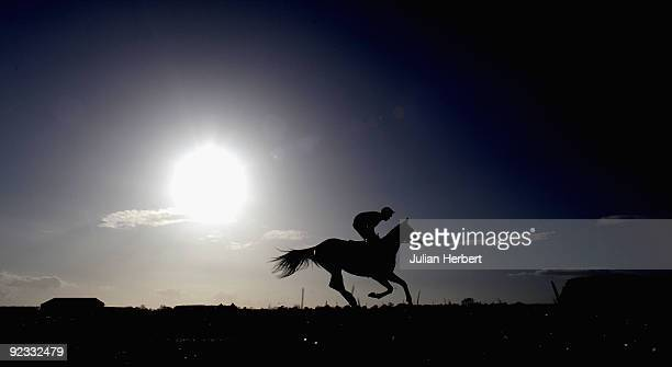 Richard Johnson and Out The Black head to the start of The FJ Chalke Desert Orchid Handicap Steeple Chase Race run at Wincanton Racecourse on October...