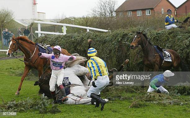 Richard Johnson flys off his horse What's up Boys as horses pile up after falling at Becher's Brook during the Grand National at Aintree Racecourse...