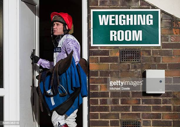 Richard Johnson heads into the changing rooms at Taunton Racecourse on January 13 2016 in Somerset England Sandhill Racing Stables set in 500 hundred...