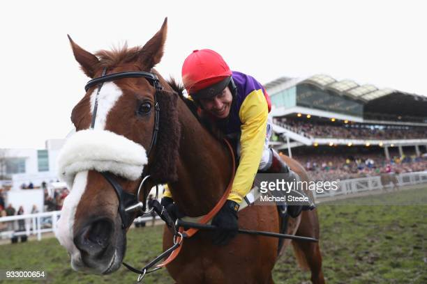 Richard Johnson hugs Native River after winning the Timico Cheltenham Gold Cup Chase during Gold Cup Day at Cheltenham Racecourse on March 16 2018 in...