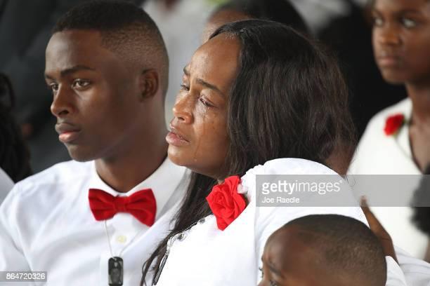 Richard Johnson jr and Cowanda JonesJohnson attend the burial service for her son US Army Sgt La David Johnson at the Memorial Gardens East cemetery...