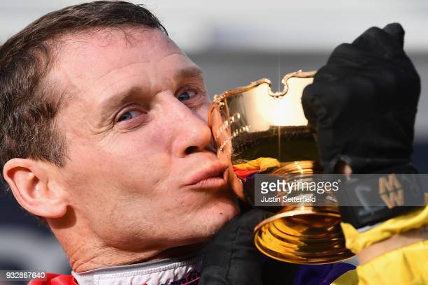 Richard Johnson kisses the Gold Cup after riding Native River to victory in the Timico Cheltenham Gold Cup Chase at the Cheltenham Festival at...