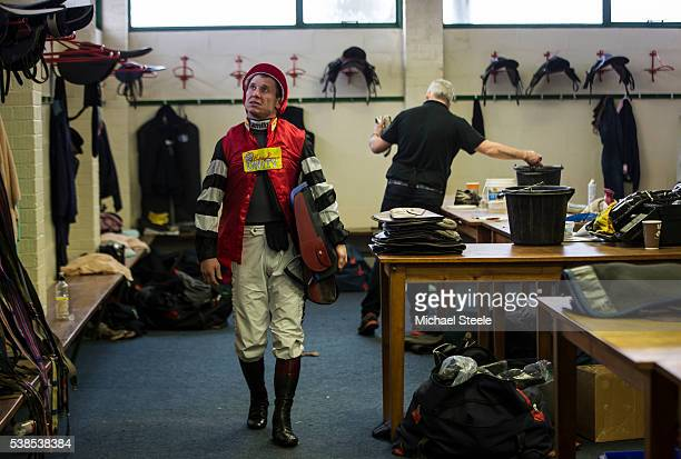 Richard Johnson looks up at the eevision screen as he leaves the jockeys changing room to weigh in at Exeter Racecourse ahead of his only race of the...