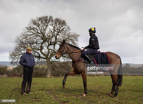 Richard Johnson on Balthazar King in conversation with assistant trainer Johnson White after a pre Cheltenham workout at Pontispool Equestrian Centre...