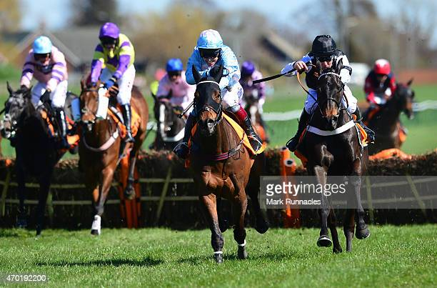Richard Johnson on board Cheltenian rides to victory during the QTS Scottish Champion Hurdle Race on the second day of the Scottish Grand National...
