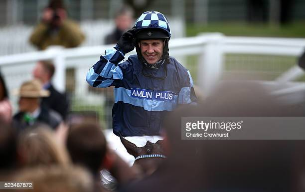 Richard Johnson on Menorah celebrates after he wins The bet365 Oaksey Steeple Chase at Sandown racecourse on April 23 2016 in Esher England