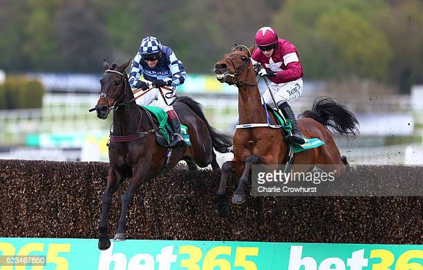 Richard Johnson on Menorah jumps the last fence with Bryan Cooper on Valseur Lido to win The bet365 Oaksey Steeple Chase at Sandown racecourse on...