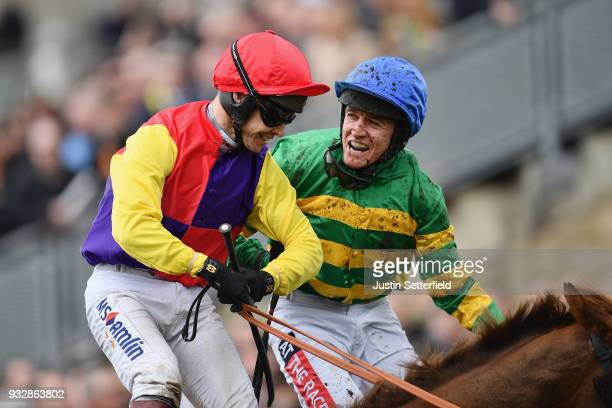 Richard Johnson on Native River is congratulated by Barry Geraghty on Anibale Fly after winning the Timico Cheltenham Gold Cup Chase at the...