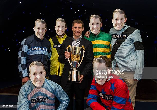 Richard Johnson poses with his Champion Jockey trophy alongside jockeys from the Sandhill yard at an end of season party at Sandhill Racing Stables...